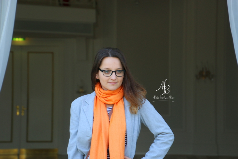 Casual grey meets orange scarf in Vienna