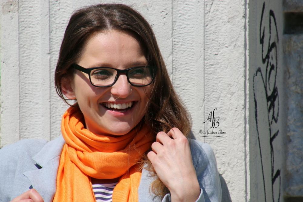Casual grey meets orange scarf in Vienna